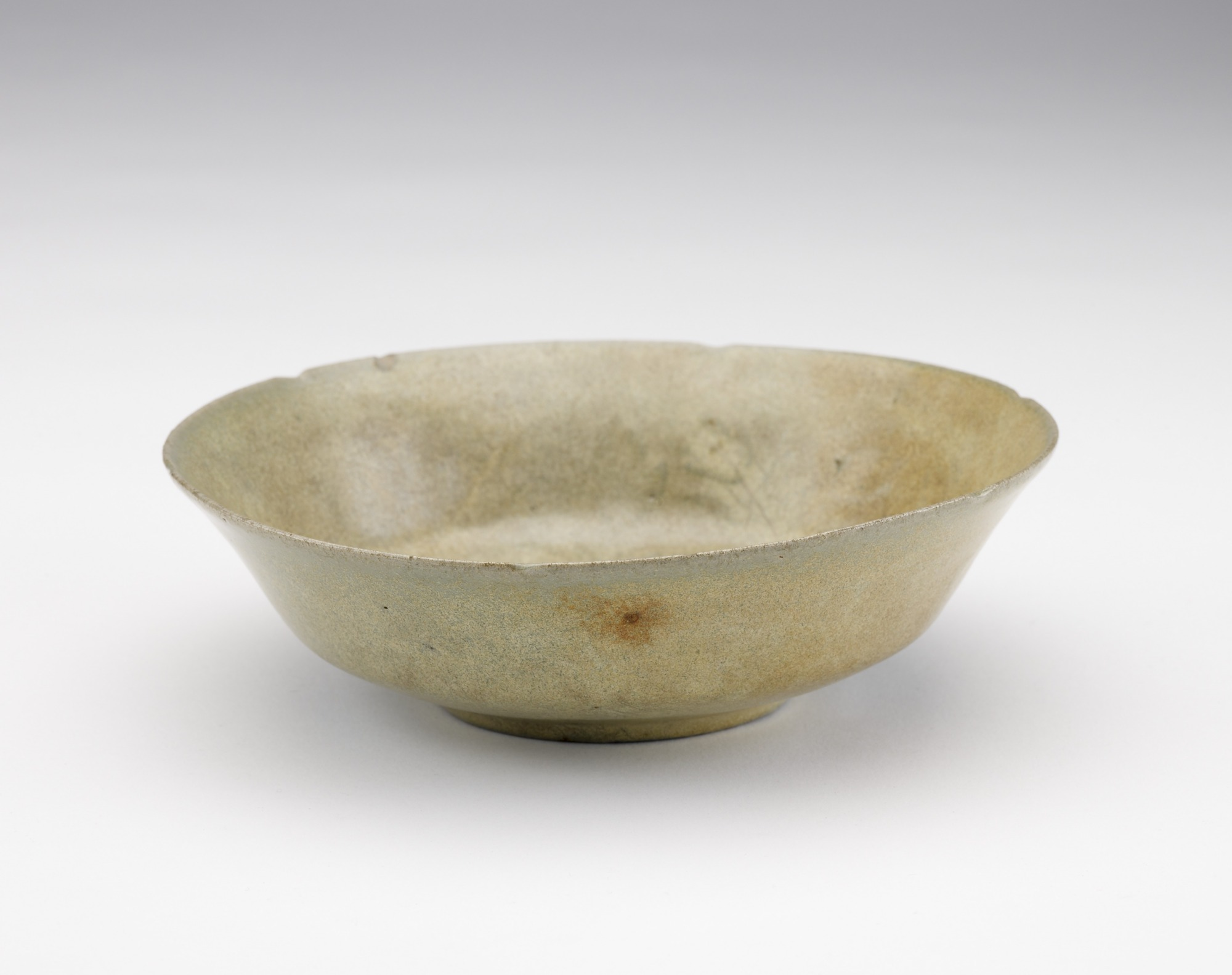 Dish with molded design of lotus, 3/4 profile