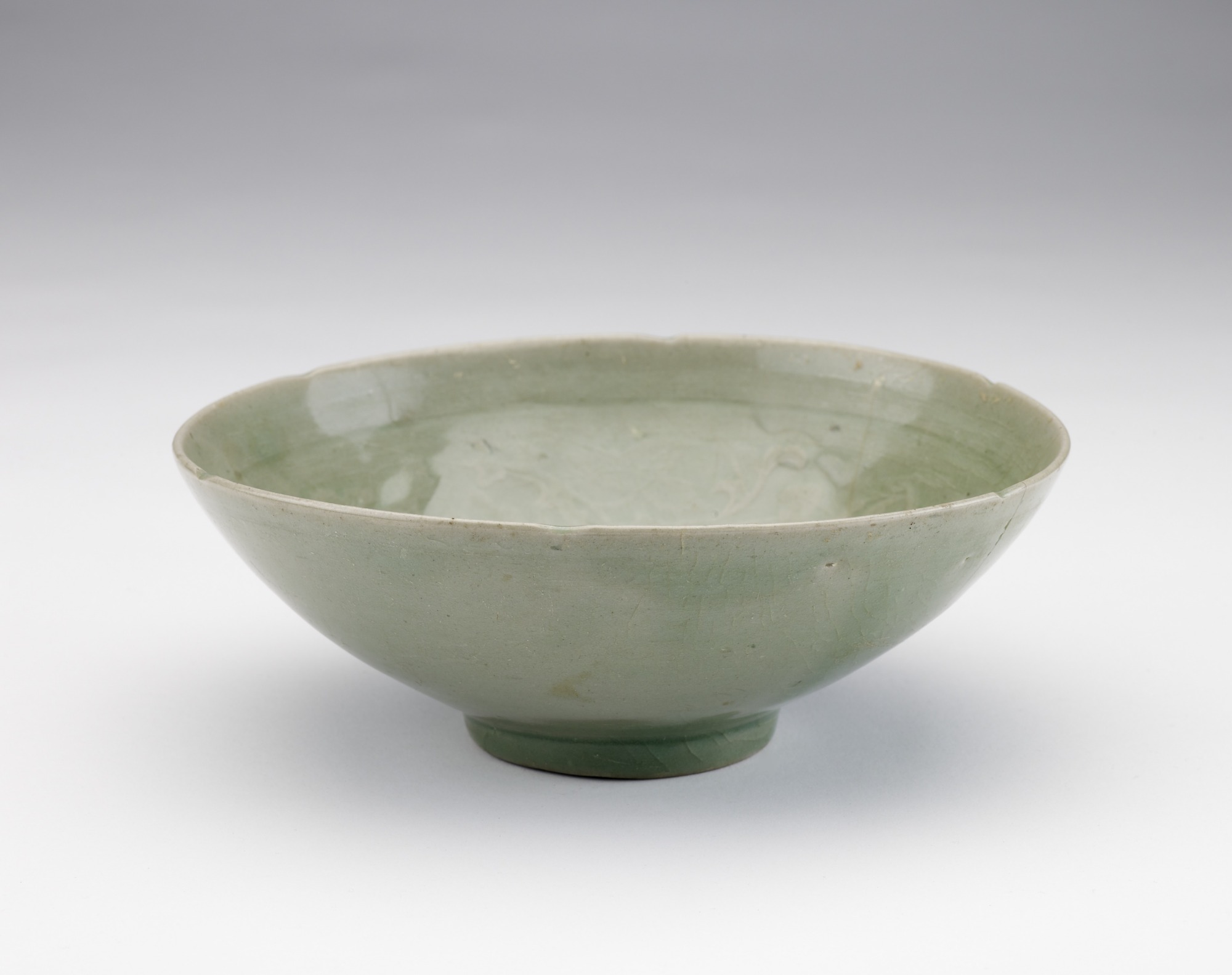 Bowl with molded and incised design of three boys among lotus vinesrcrolls, 3/4 profile