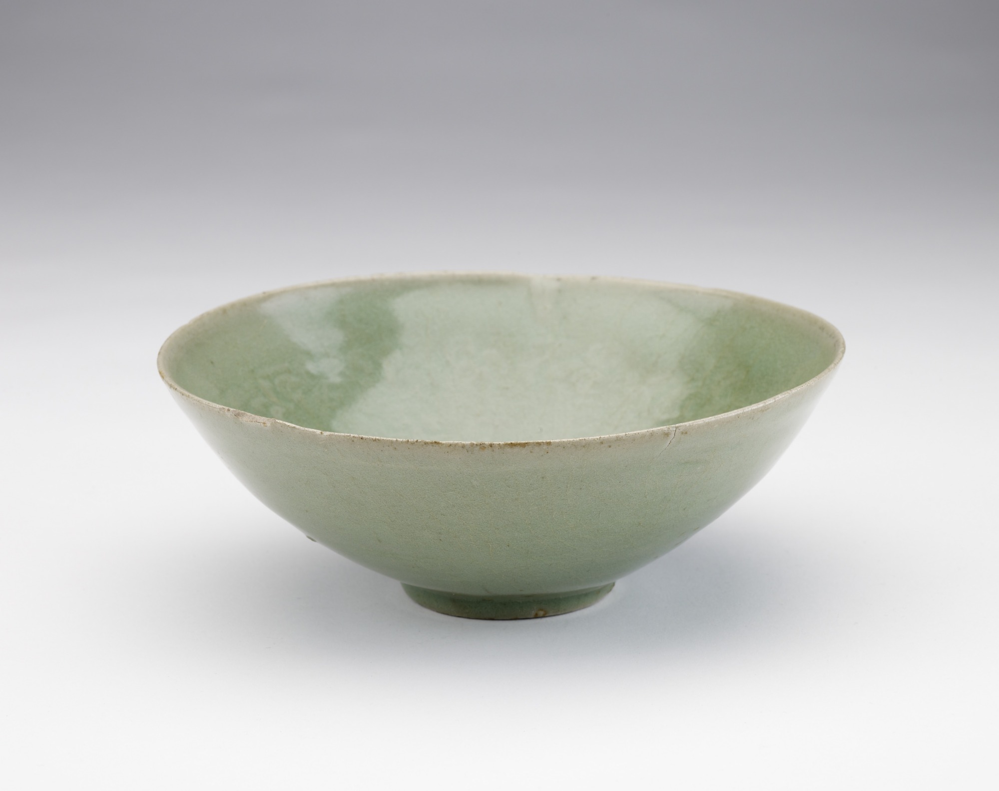 Bowl with molded vinescroll decor, 3/4 profile