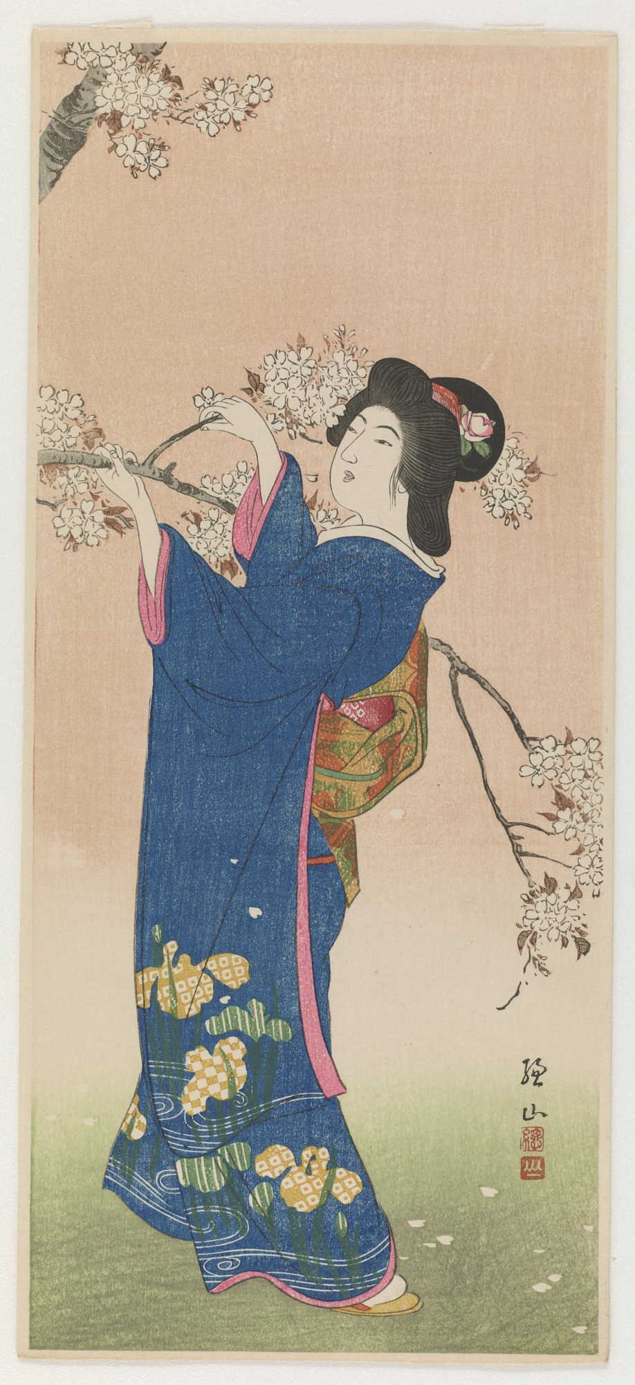 : Woman and flowering cherry branch