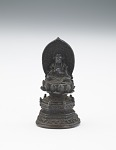 Enthroned Buddhist divinity with halo