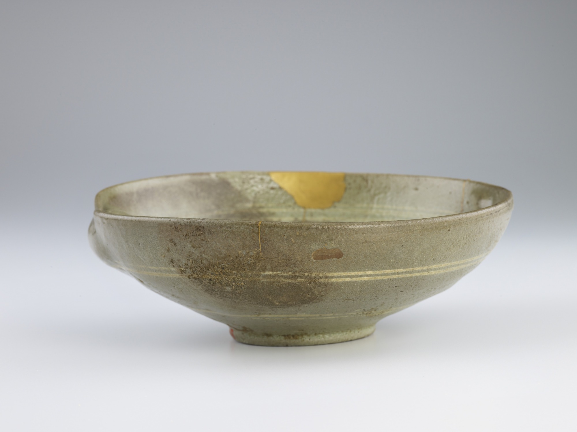 Bowl with inlaid design of willow trees, ducks, and grass, profile