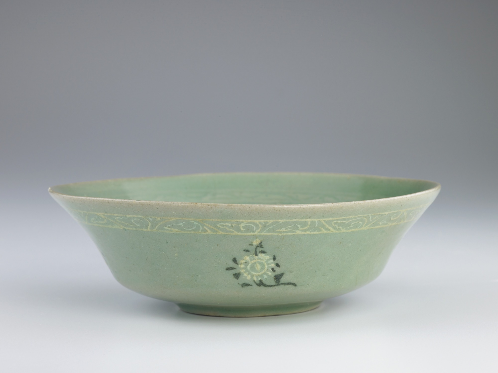 Dish with mold-impressed and inlaid decoration, profile