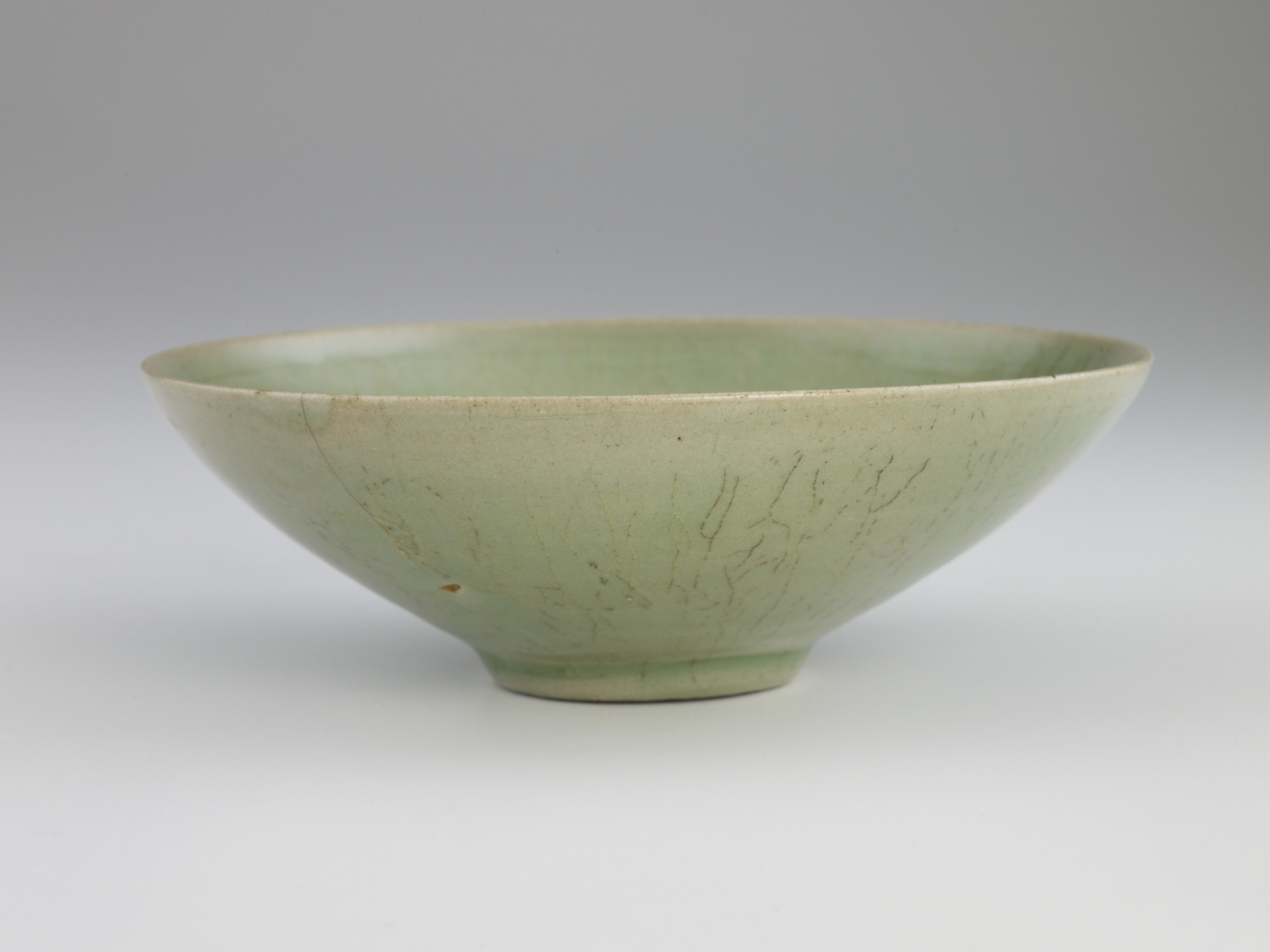 Bowl with incised design of fish among waves, profile
