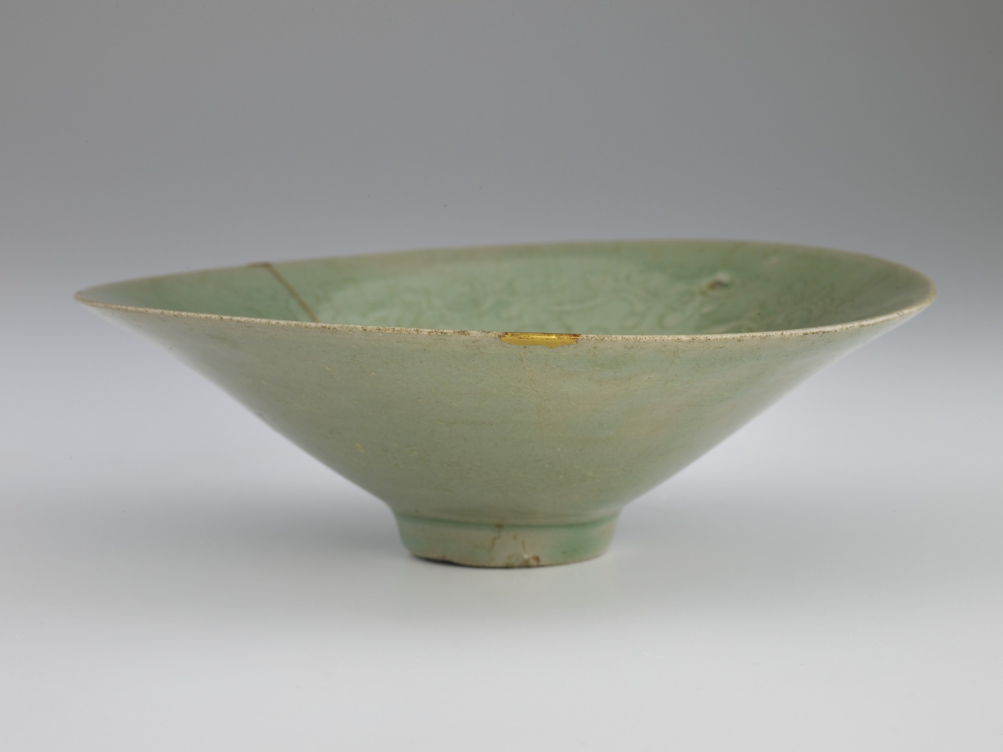 Bowl with molded and incised design of cranes and clouds, profile