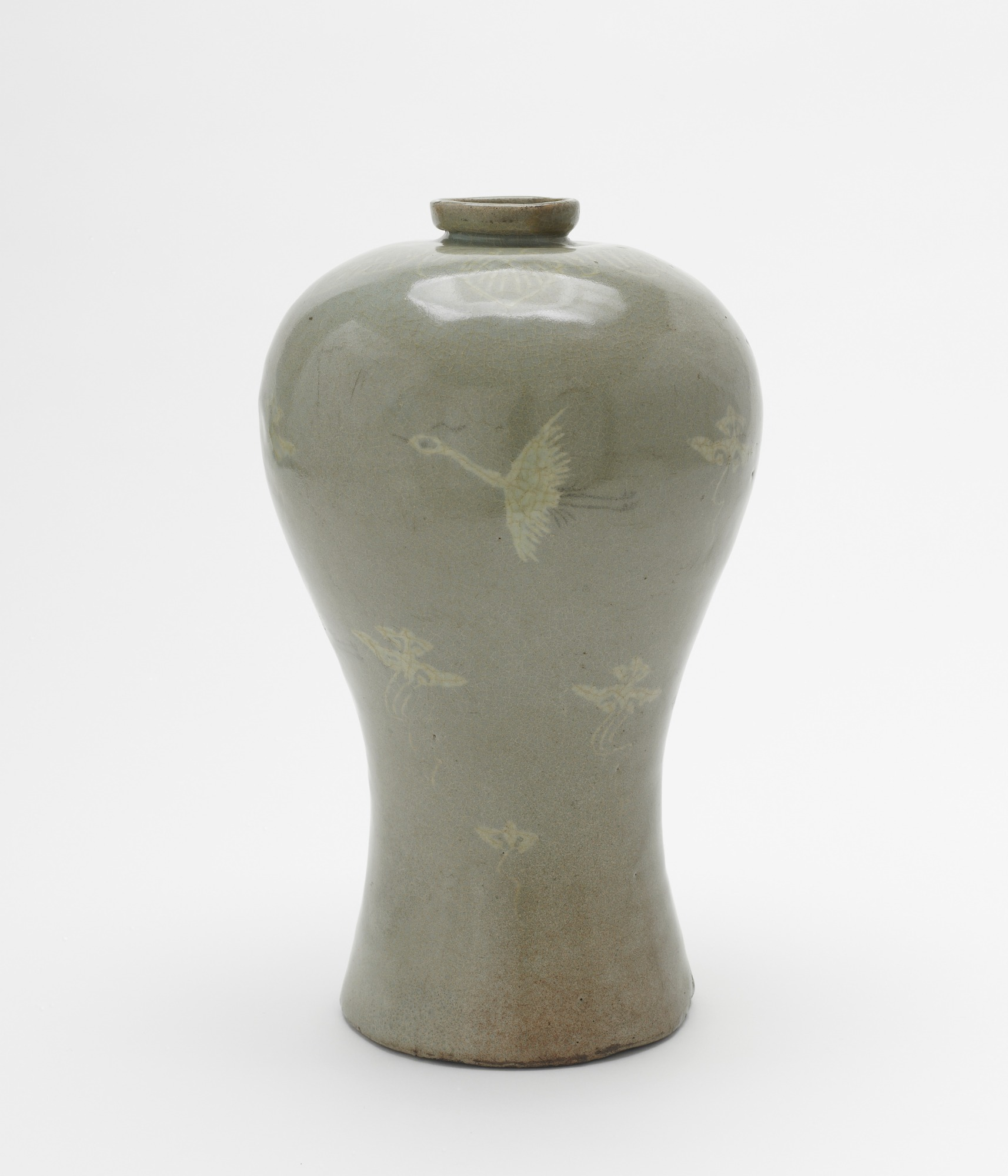 Bottle with inlaid decoration of flying cranes and clouds, profile