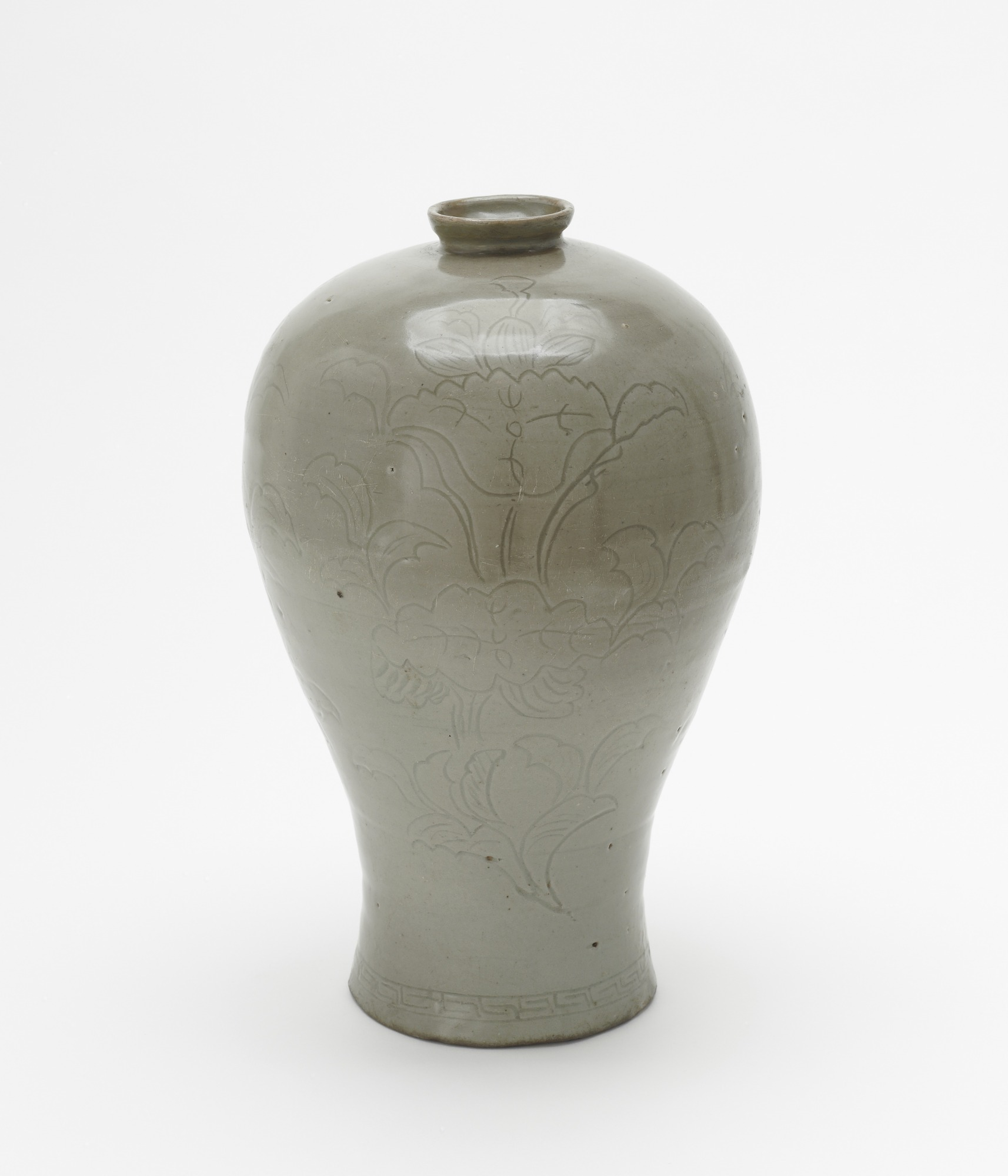 Bottle with incised decoration of three lotus sprays, profile