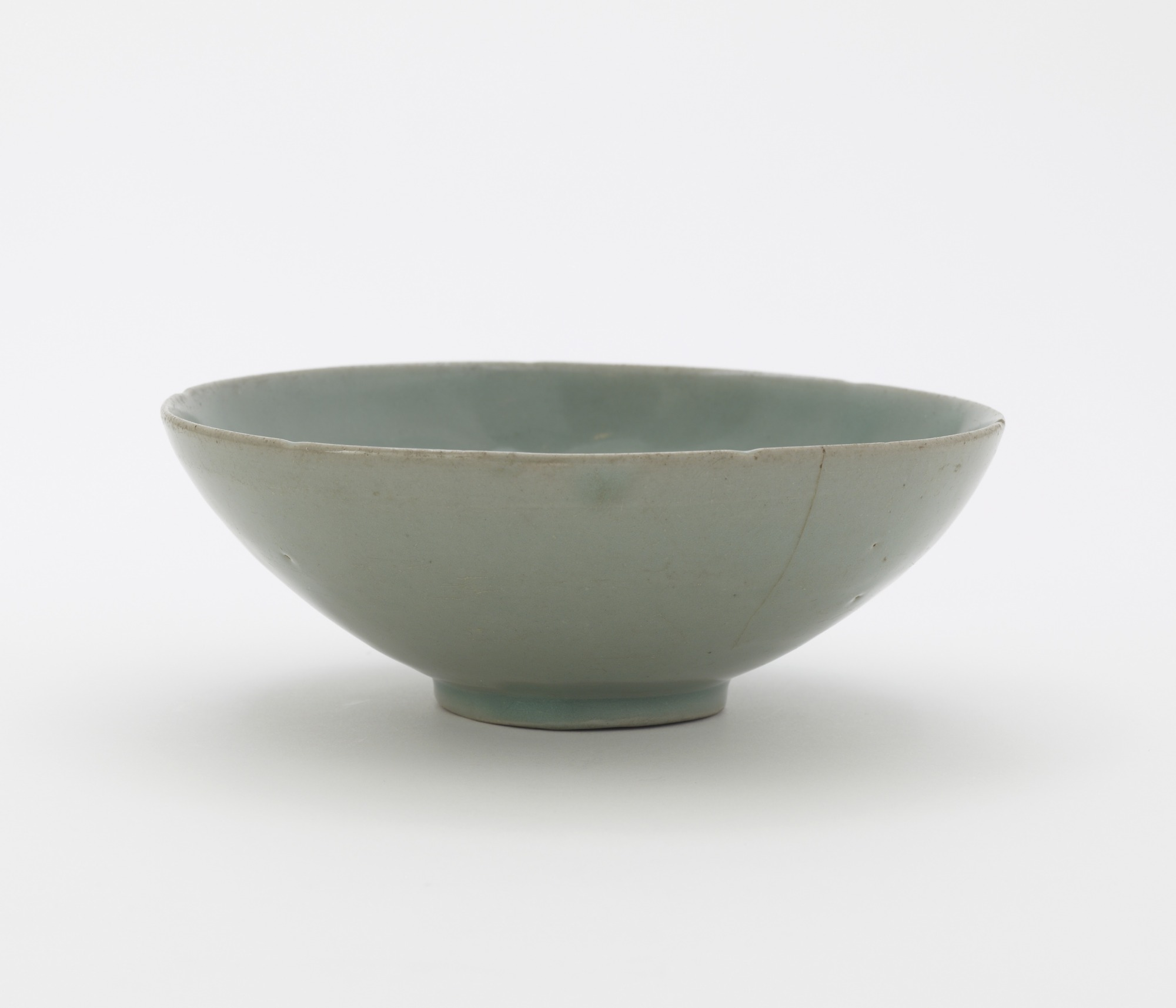 Bowl with molded decoration of peony blossoms, profile