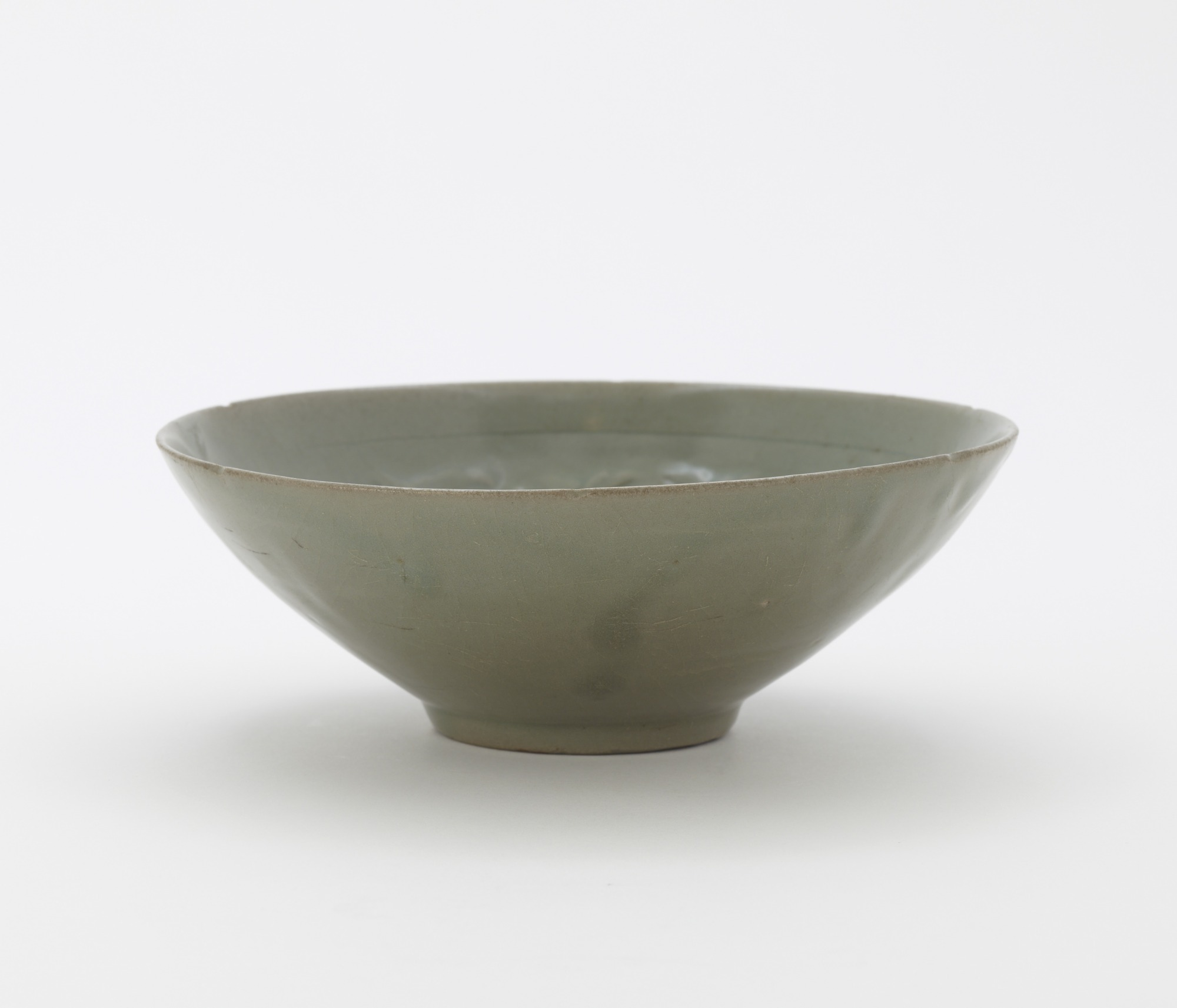 Bowl with molded and incised design of three boys among vinescrolls, profile