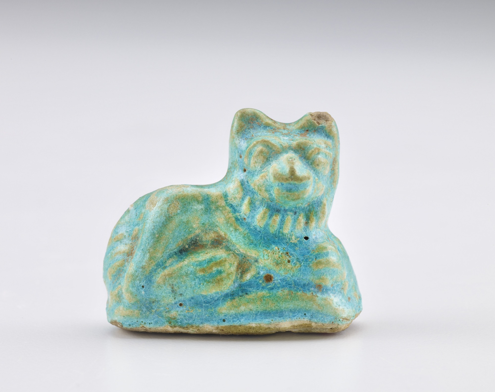 front: Figure of a small reclining animal