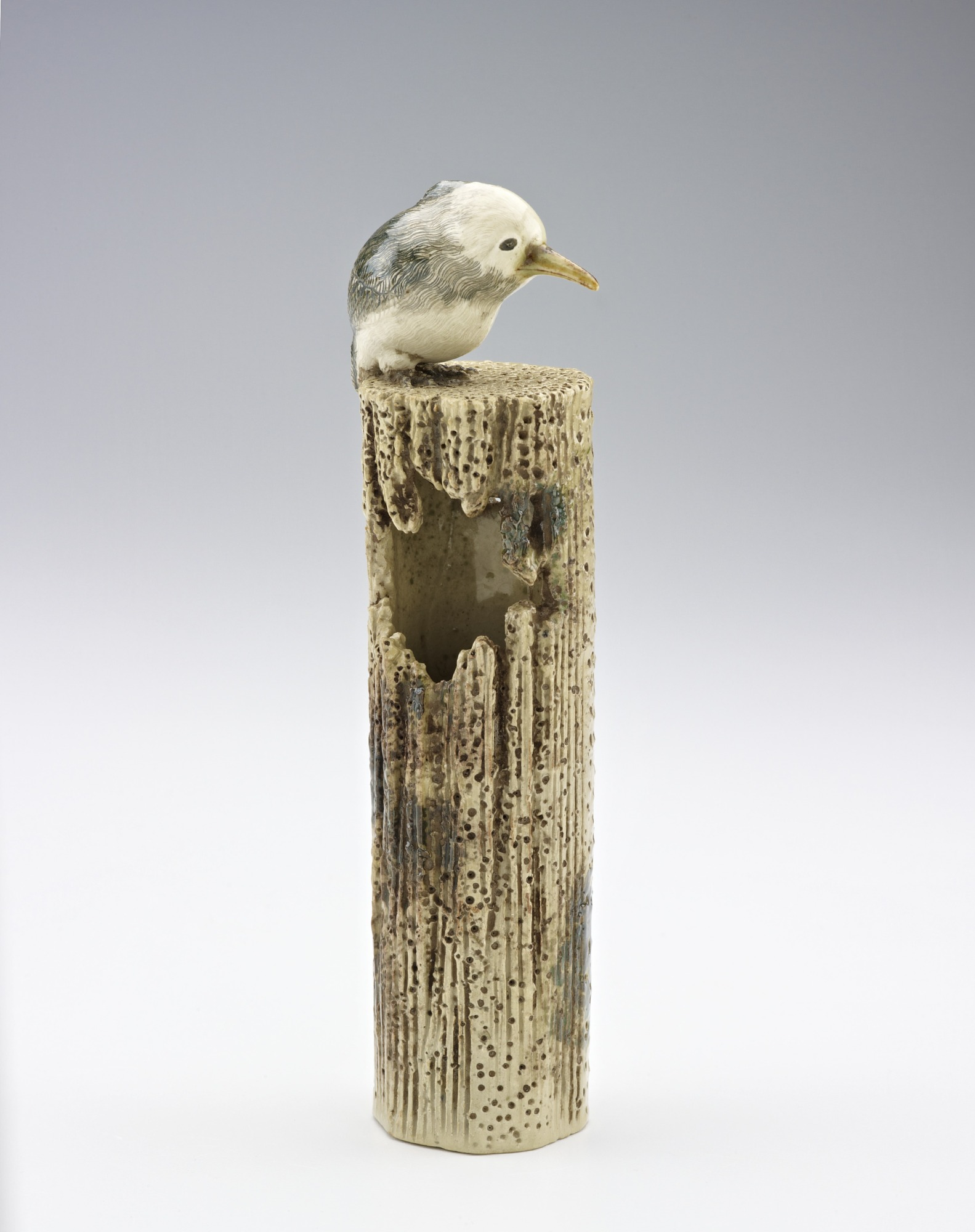 Vase in form of kingfisher on post
