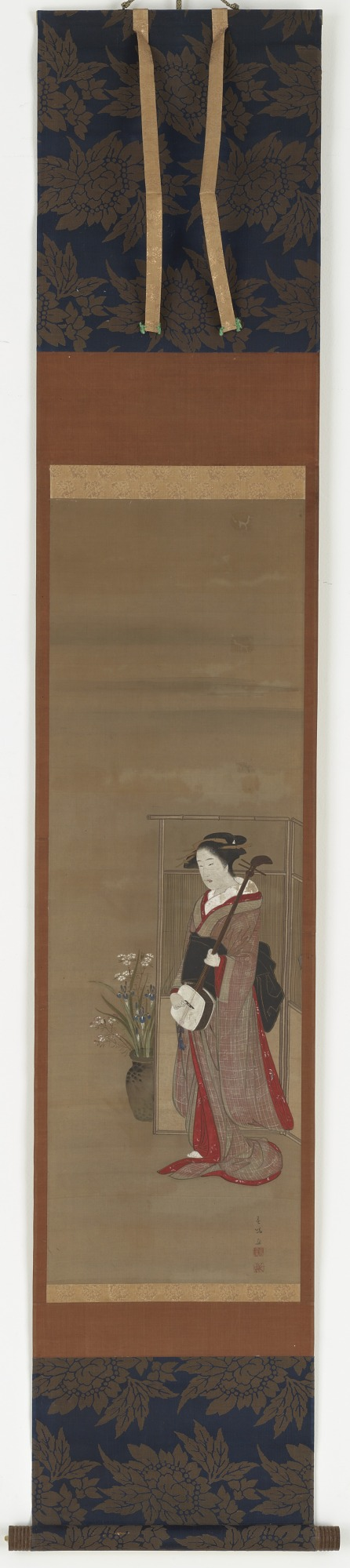 Girl with a samisen standing beside a screen