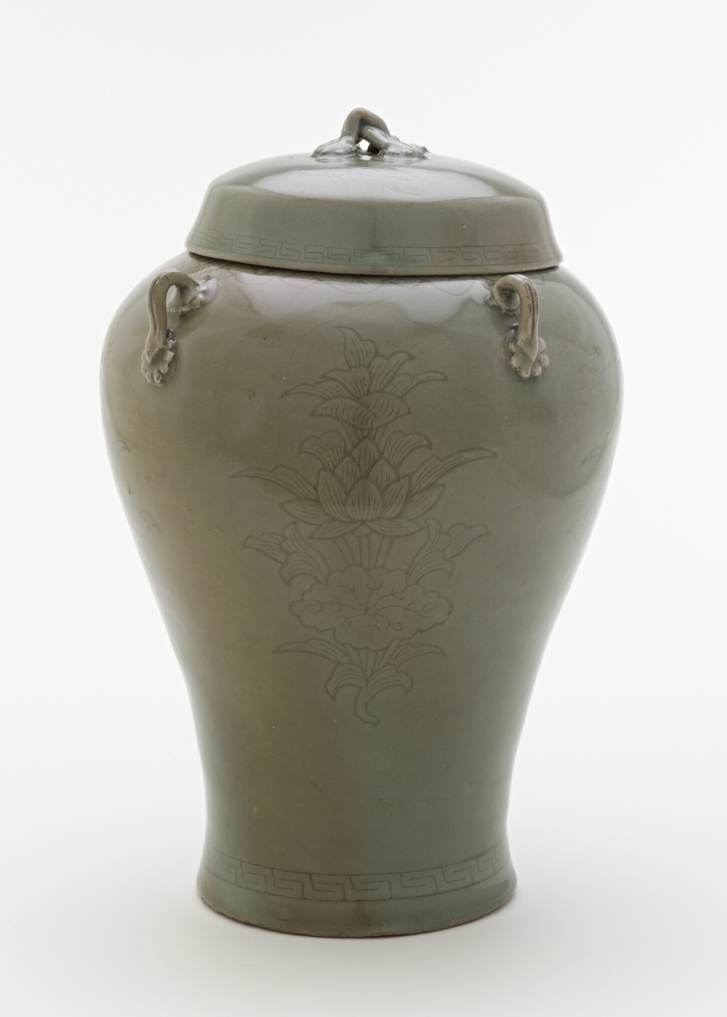 Jar with incised design of lotus sprays, profile with lid
