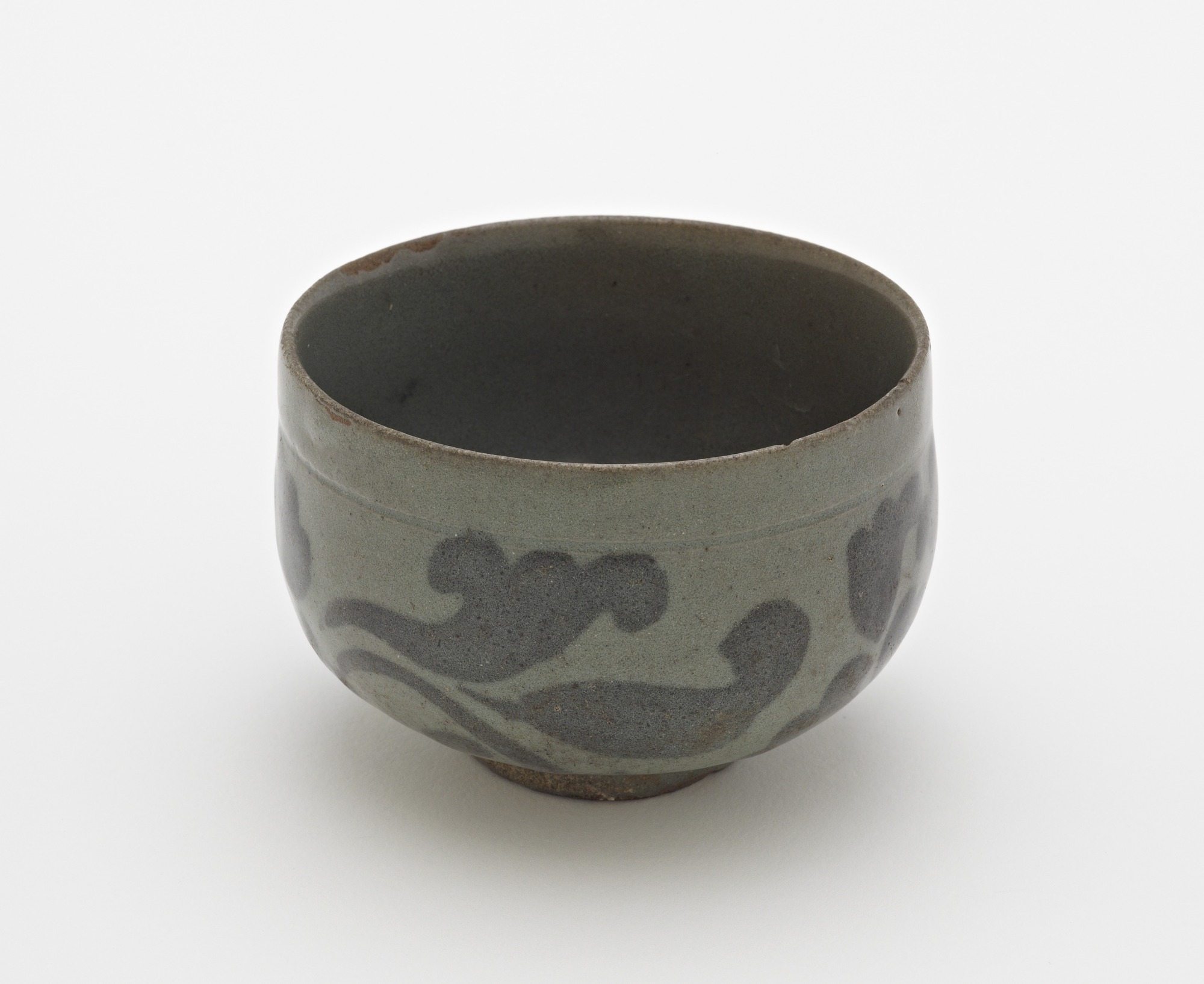 3/4 profile: Cup with design of peony blossoms