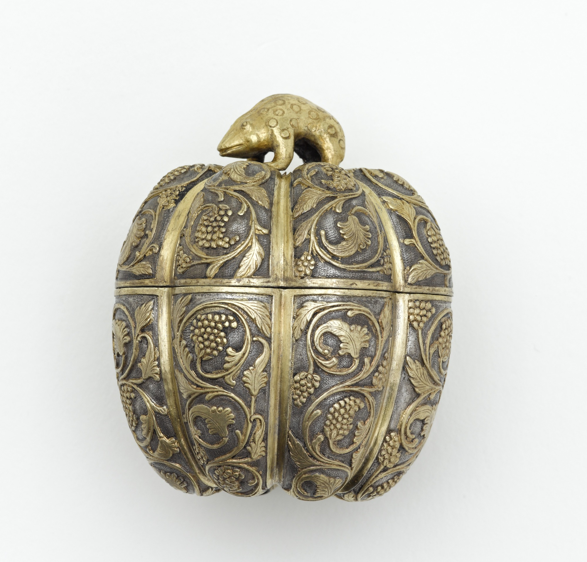 profile: Lidded box in the form of a melon with grapevines and knob in the shape of a rodent