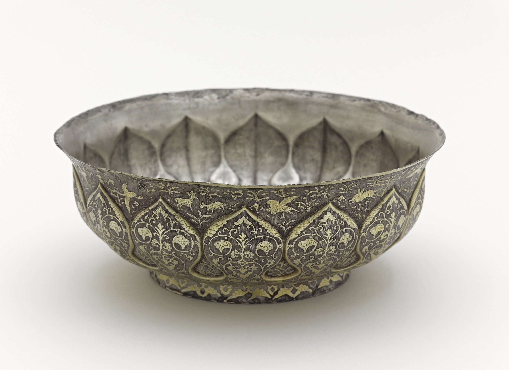 3/4 profile: Lobed bowl with lotus petals, birds, animals, and floral scrolls