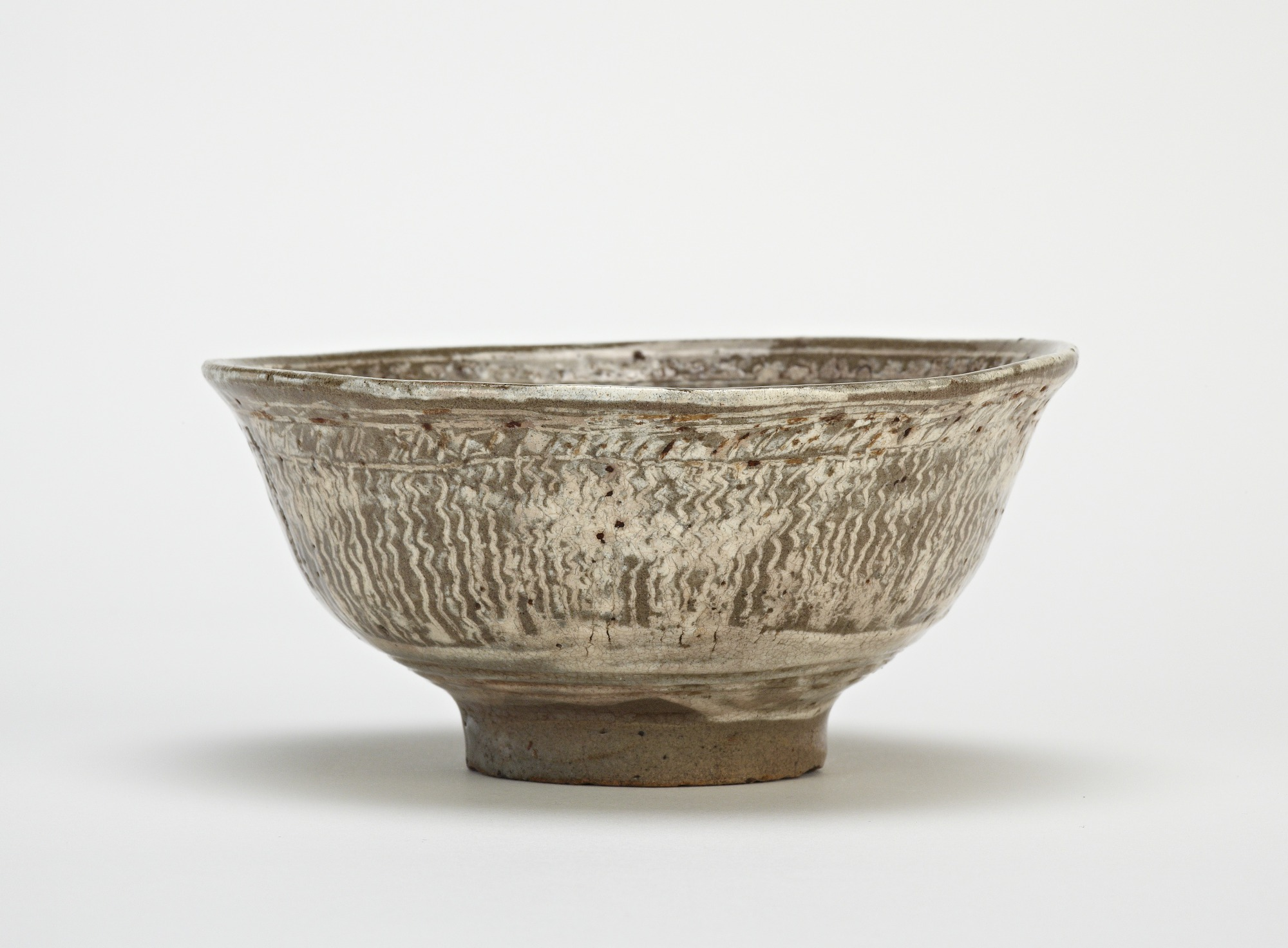 Tea bowl, mishima type, profile