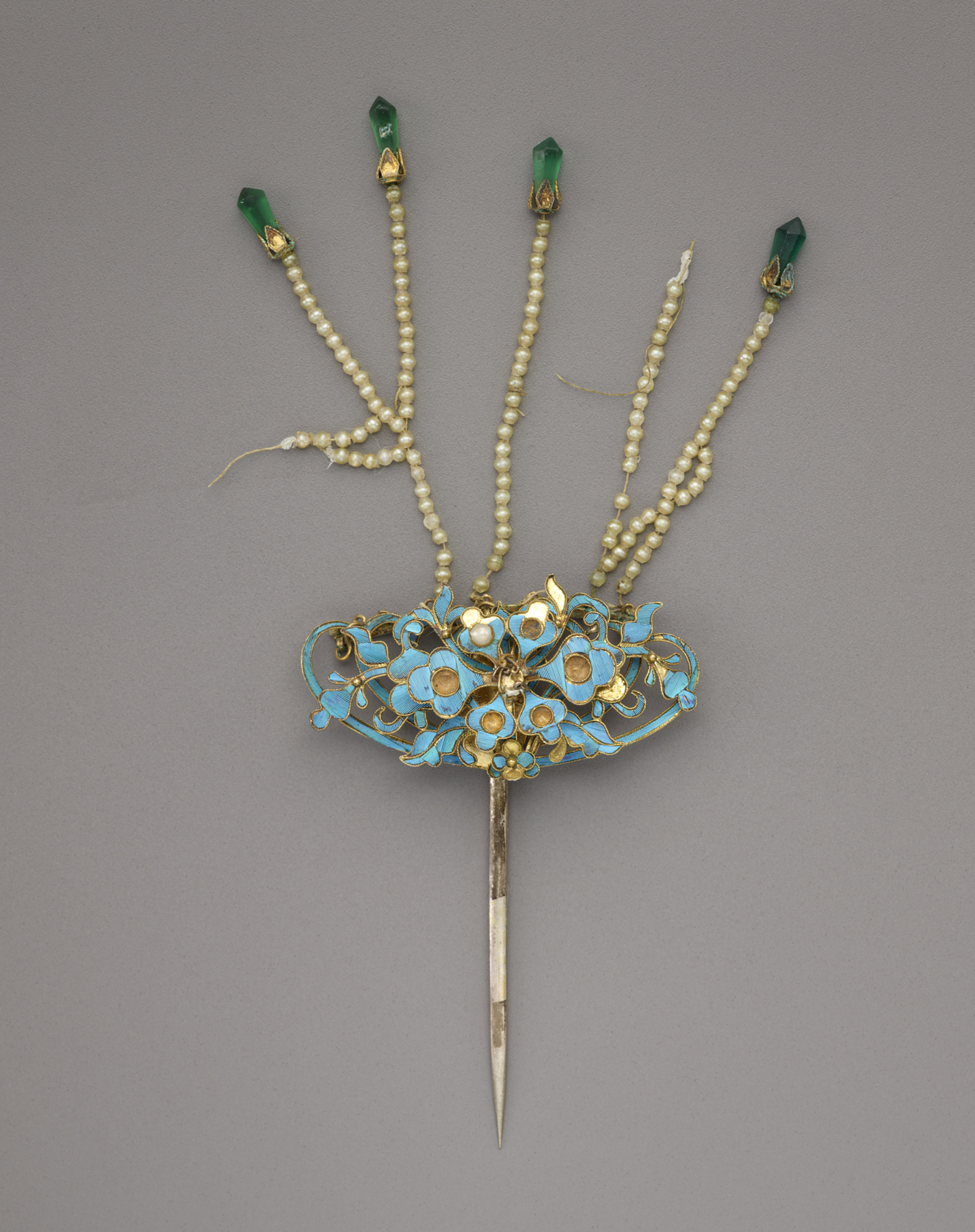 Single prong kingfisher feather hairpin with floral motif and dangles