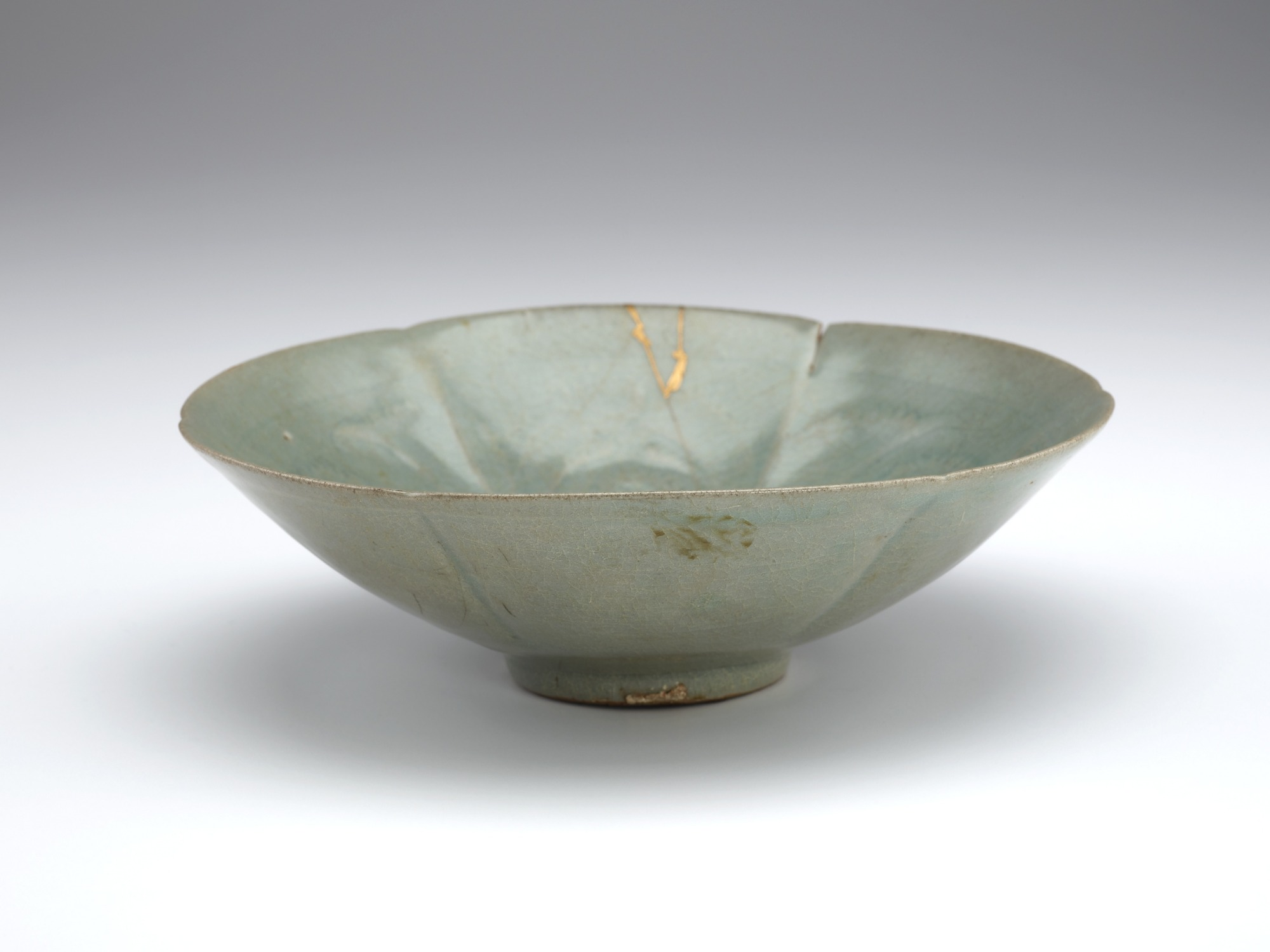 Bowl with molded six-lobed form and design of peony, 3/4 profile