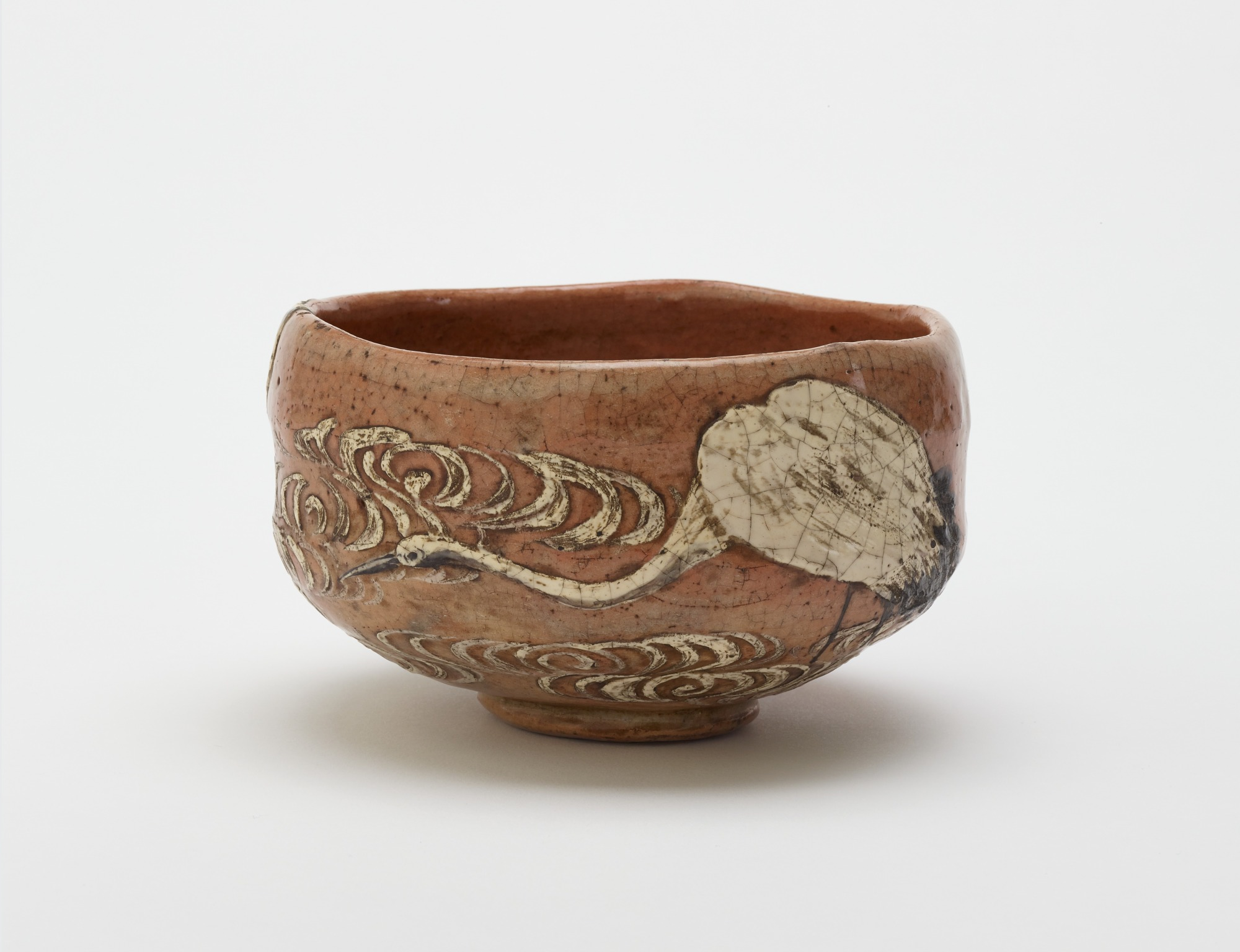 profile: Kenzan style tea bowl with design of crane and flowing water