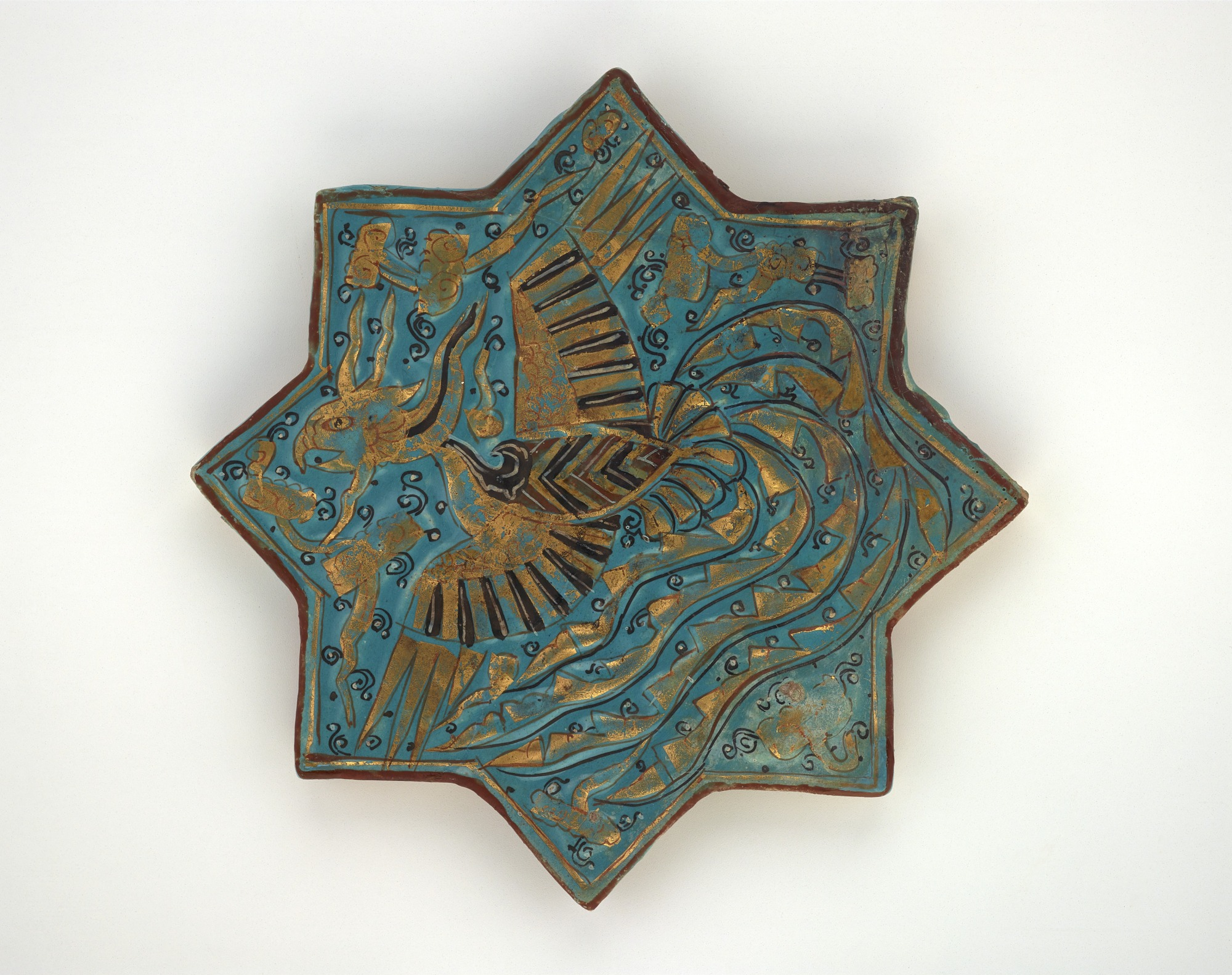 front: Star tile with phoenix