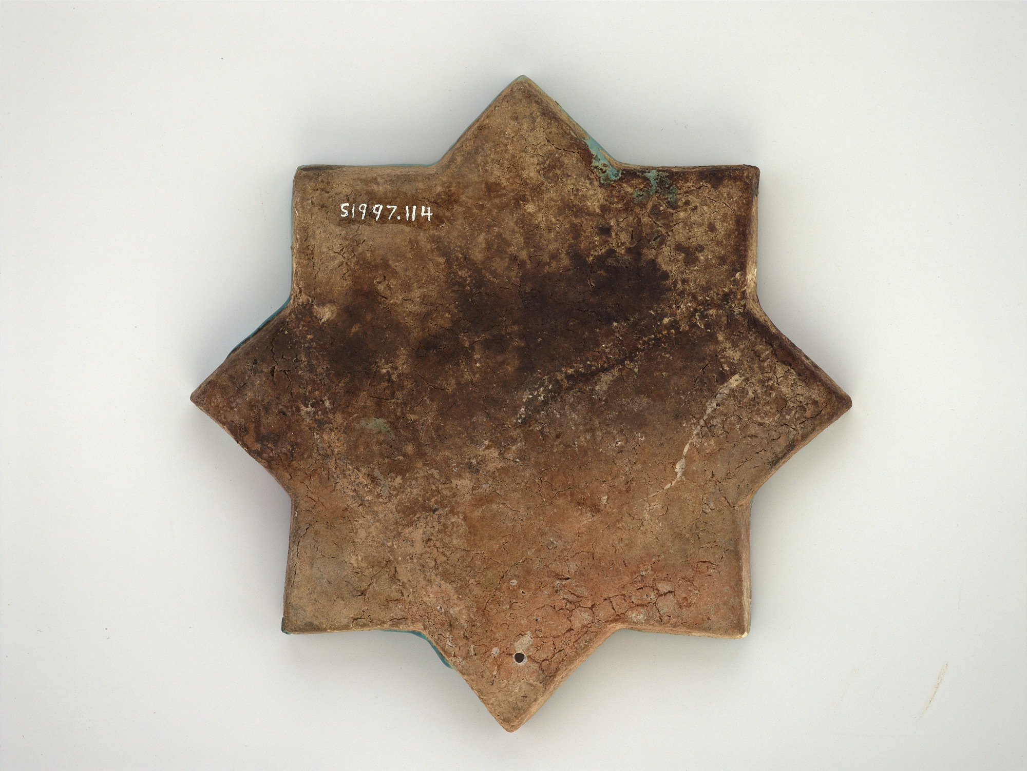 back: Star tile with phoenix