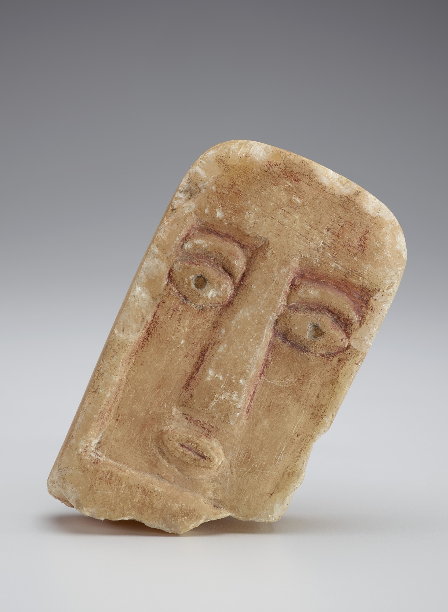 Stela fragment with human face