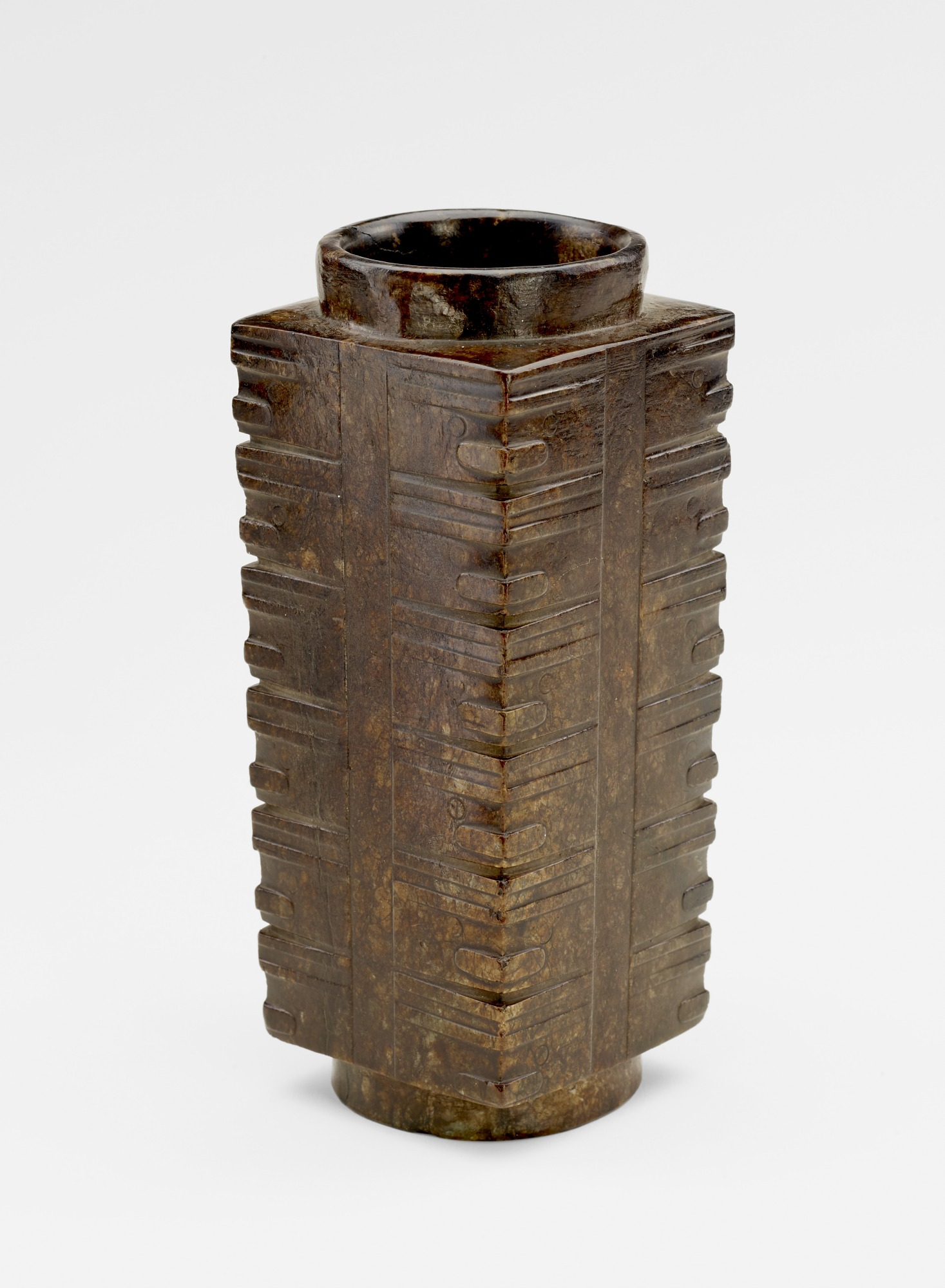 Six-tier tube (<i>cong</i> 琮) with masks, probably recut