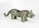 One of a pair of tigers, possibly the base supports for a bell stand