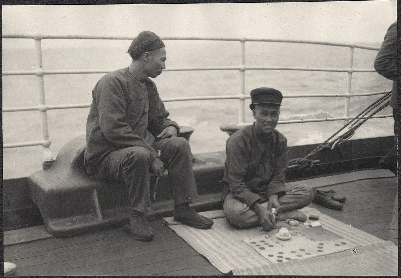 Chinese passengers aboard the Manchuria, playing a gambling game