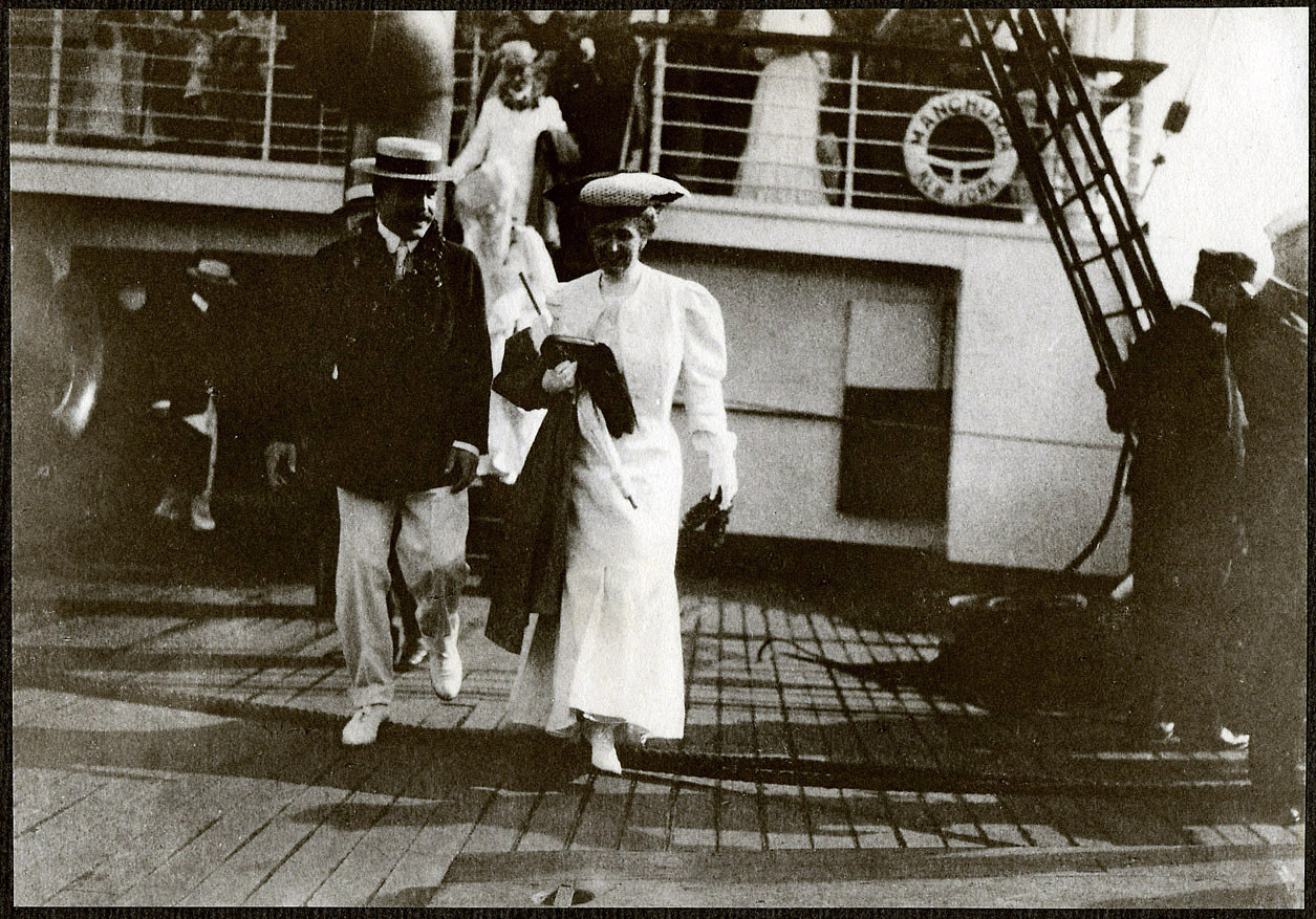 Nicholas Longworth and unidentified woman walking on deck of the SS Manchuria upon arrival in Hawaii.