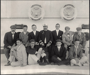 A group photograph of Harvard alumni passengers aboard the SS Manchuria including Nicholas Longworth and Capt. J. W. Saunders.