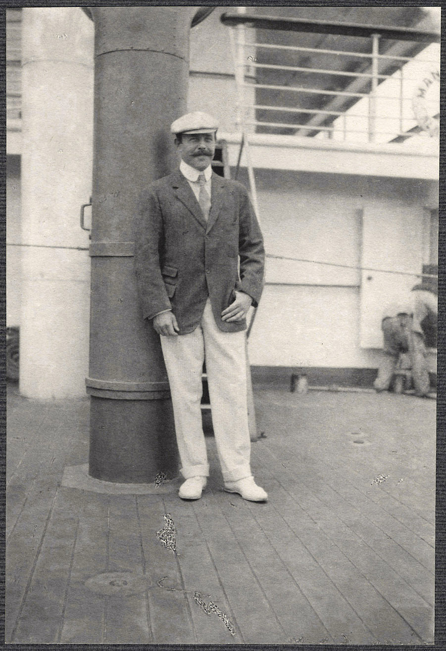 Nicholas Longworth Standing by a Smokestack on board the SS Manchuria.