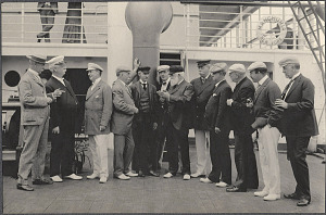 Male members of the Delegation conversing on deck the SS Manchuria.