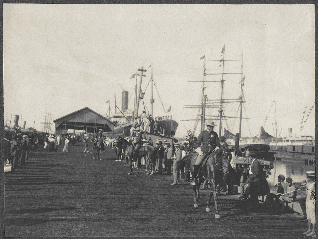 Honolulu dock with soldiers on horseback