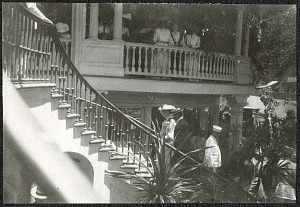 Alice Roosevelt ascending staircase with Governor Atkinson