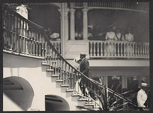 Onlookers watch Alice Roosevelt ascend a staircase