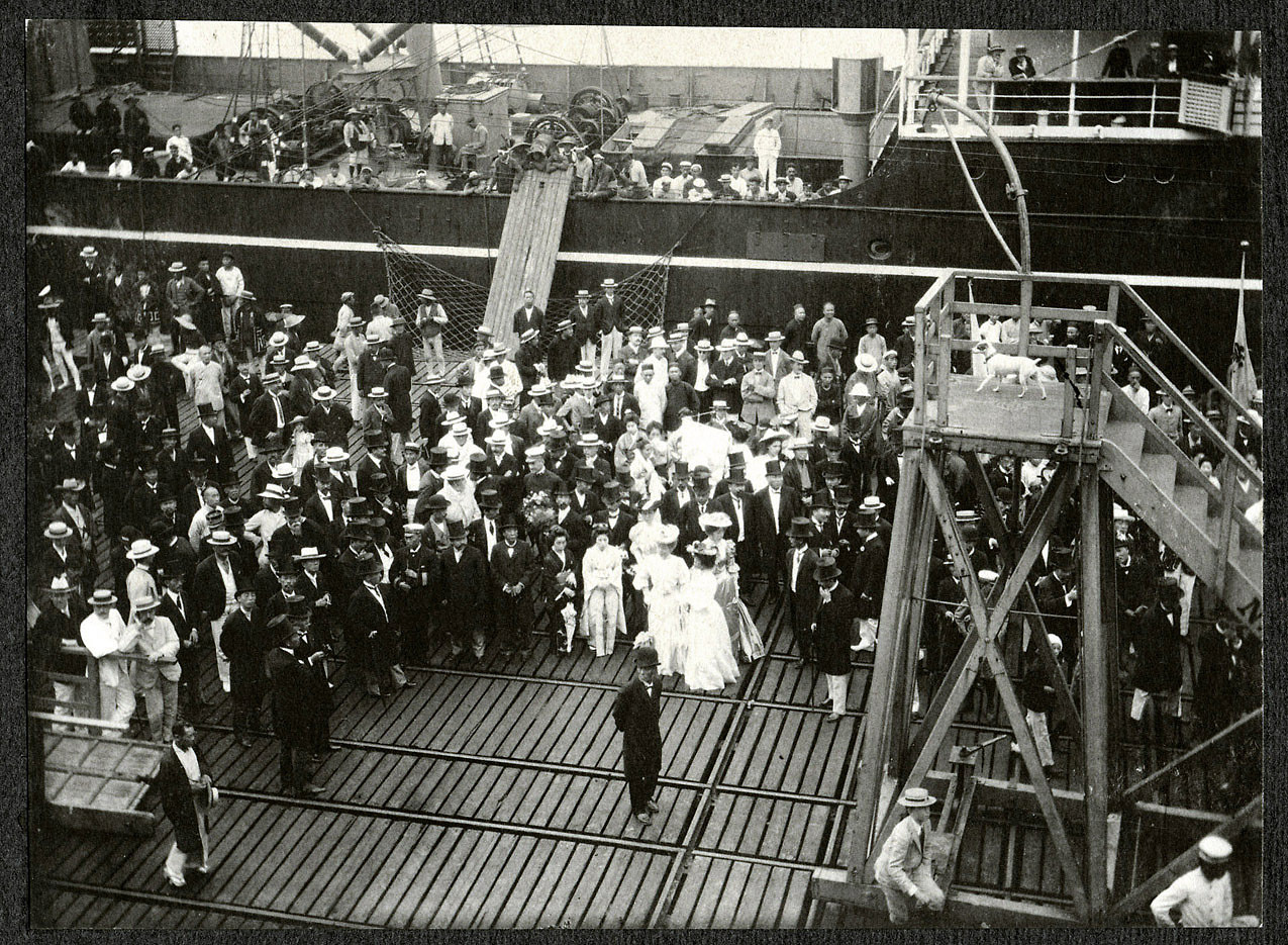 Yokohama: Dignitaries in top hats await SS Manchuria passengers