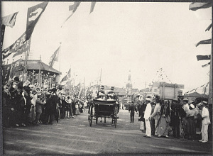 Tokyo: Alice Roosevelt in a carriage rides among flag waving crowds leaving Shinbashi Station