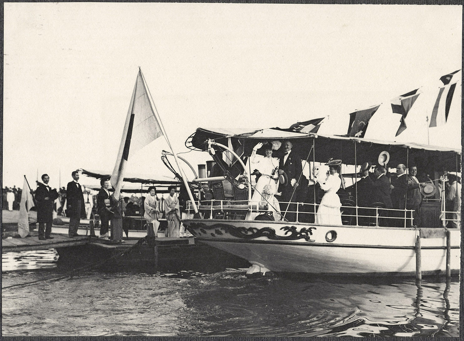 Alice Roosevelt and others wave from launch at Kobe port en route to S.S Manchuria