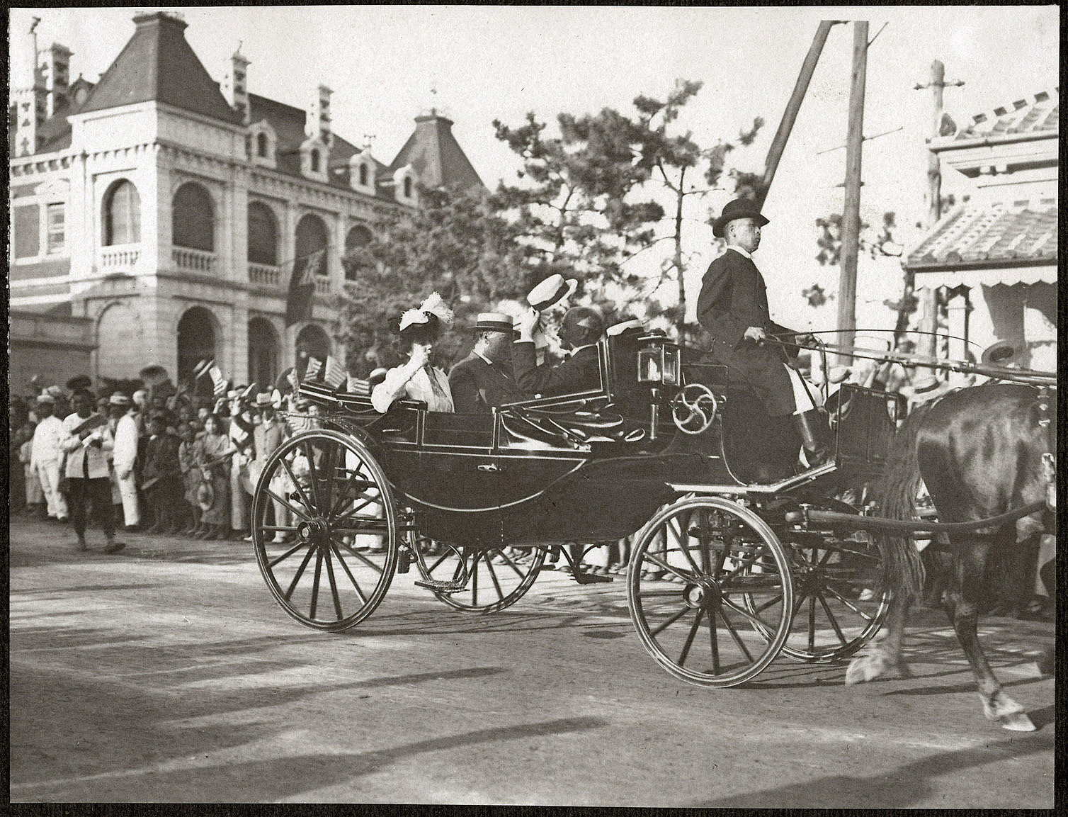 Kobe: William H. Taft and Alice Roosevelt passing cheering crowds on the Bund