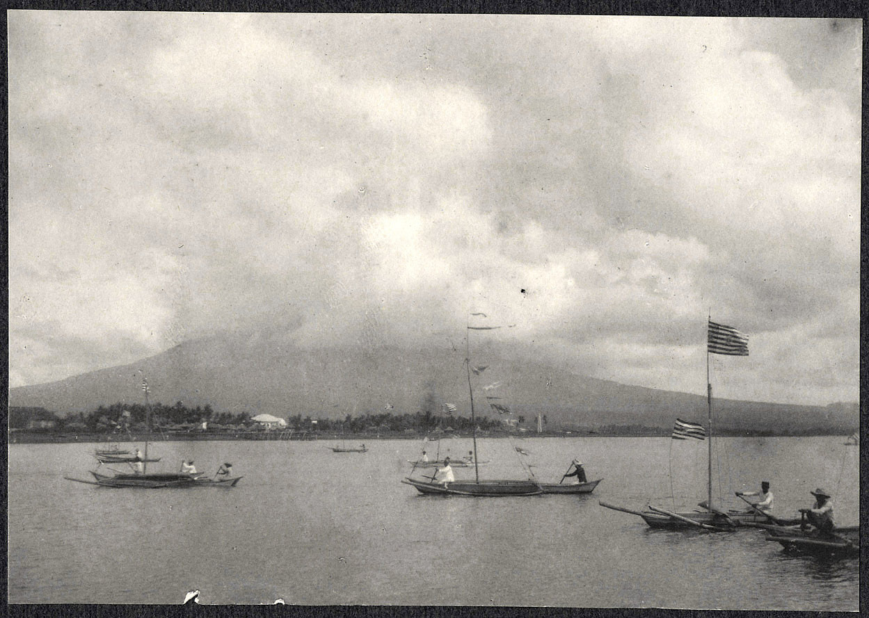 Legazpi: Small boats in harbor, with Mayon Volcano in the distance