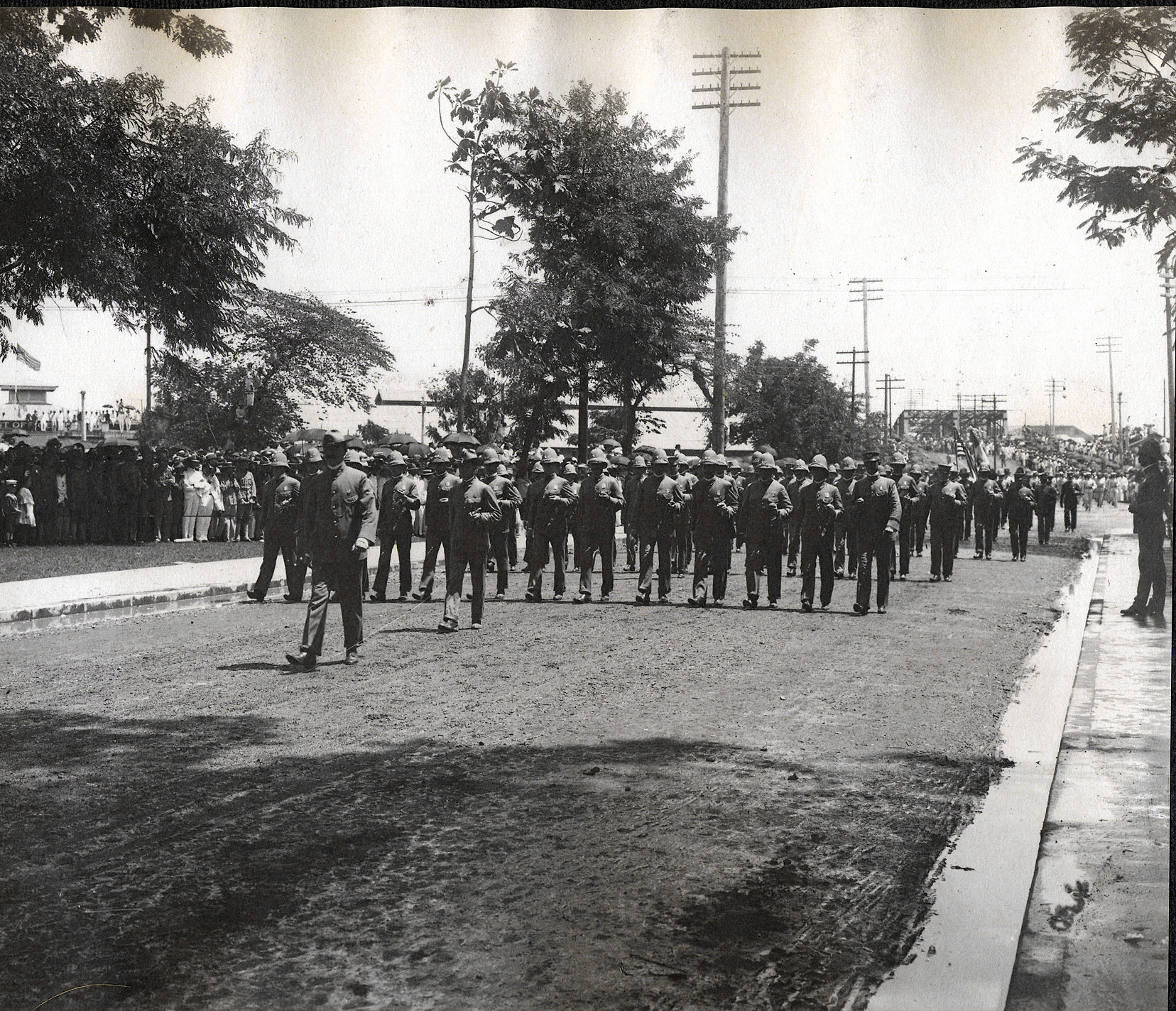 Manila: Soldiers march past viewing stand, Santa Cruz Bridge in the background