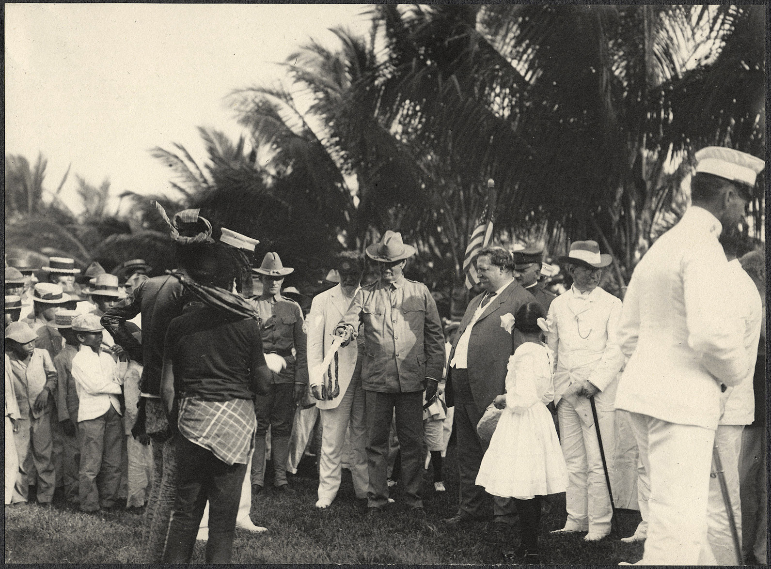 Zamboanga: Wiiliam H. Taft watches as the Datu Piang presents a ceremonial sword to Major John Finley at Zamboanga parade grounds