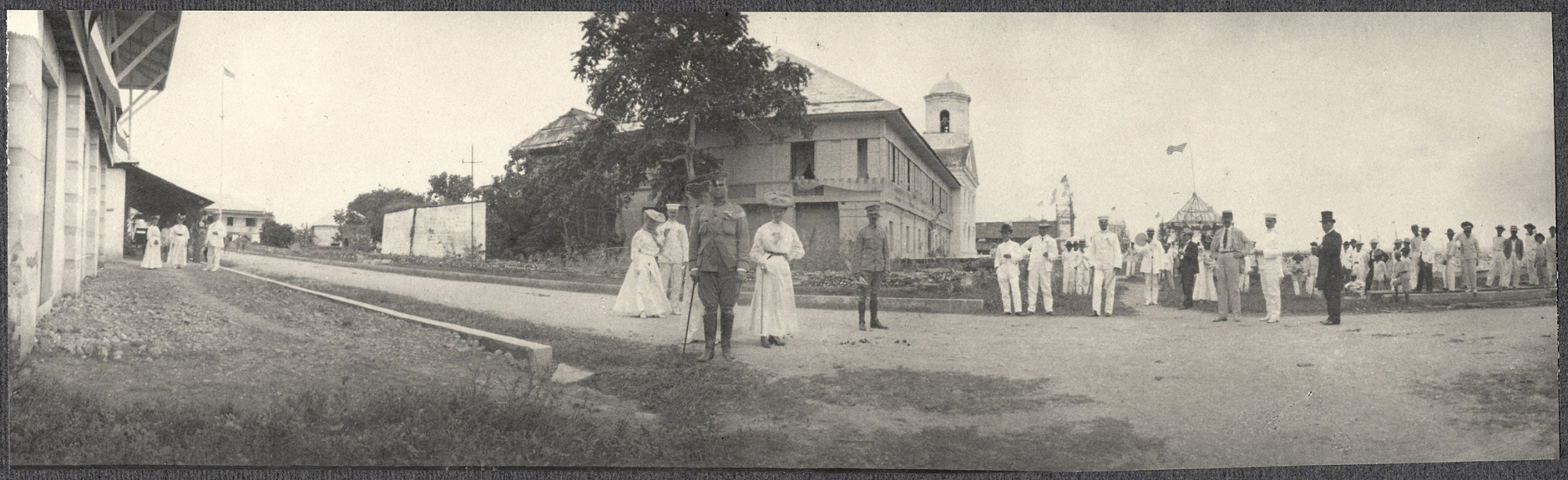 Americans on a town street, possibly Legazpi