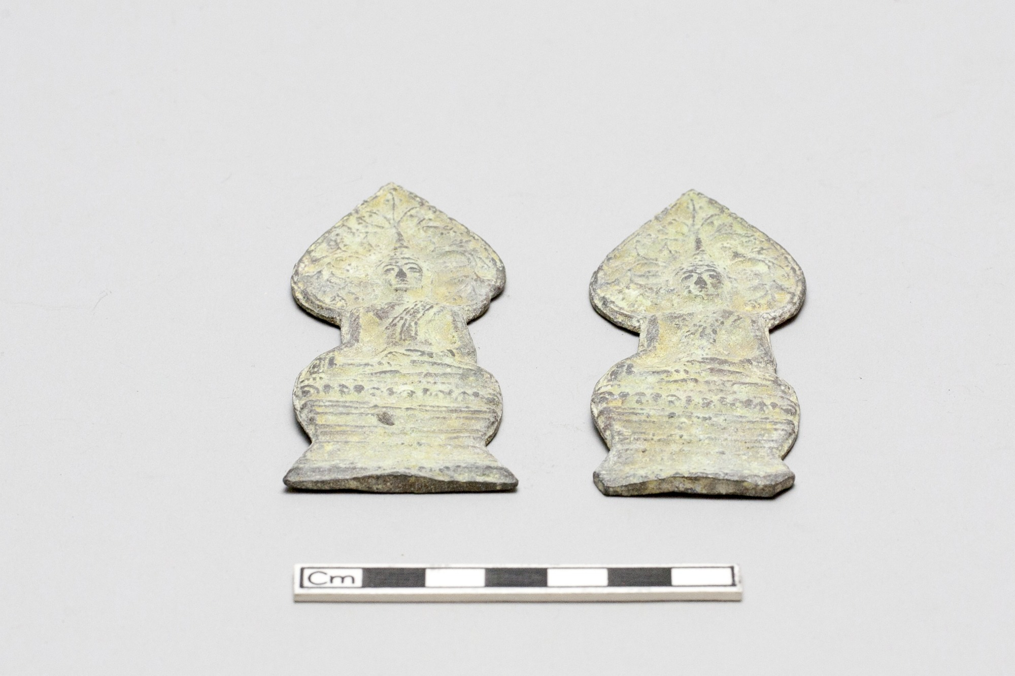 Two votive plaques