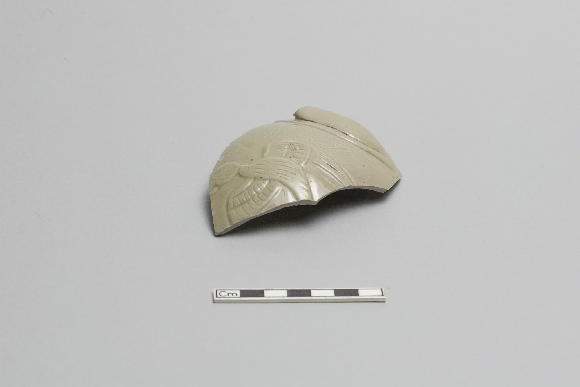 Fragment of a vessel with part of handle remaining