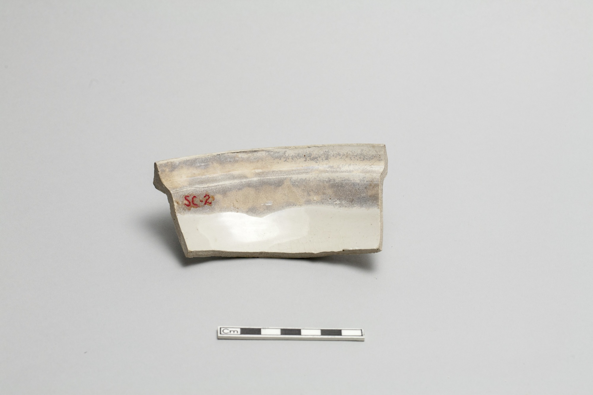 One of two fragments of a cover for a round dish or bowl (goes with FSC-P-3)