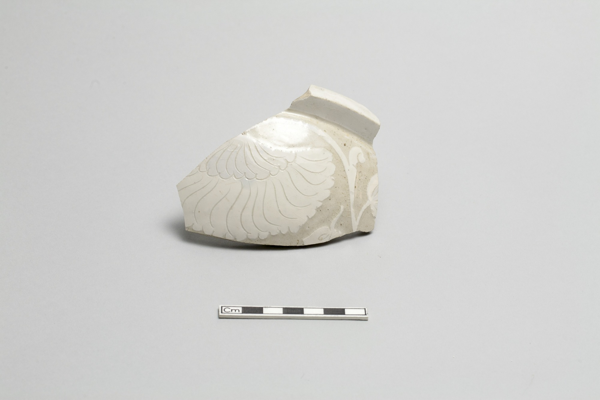 One of two fragments of a cover for a round dish or bowl (goes with FSC-P-2)