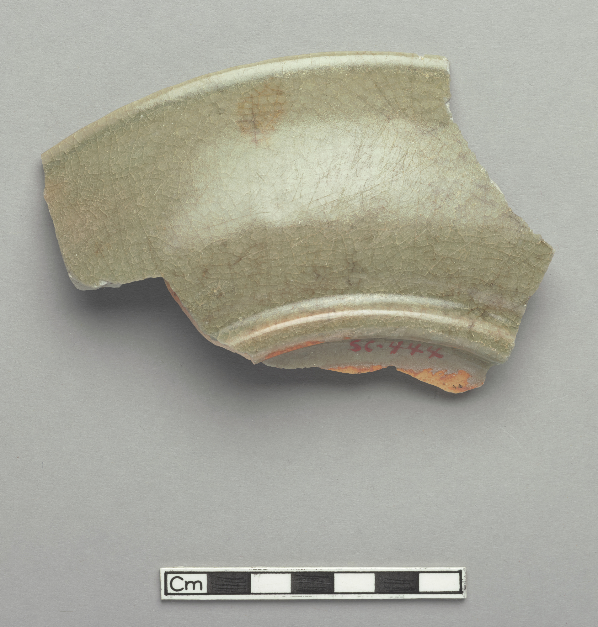 Fragment of the rim and base of low celadon dish